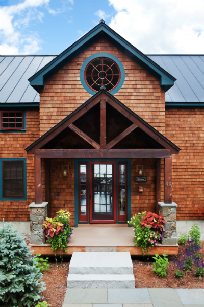 Conway lodge style home plans yankee barn homes for Outdoor foyer ideas