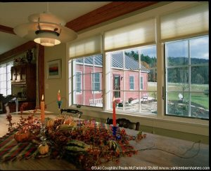 Through the dining room wondow is a view of the old cape in it's new capacity as master bedroom.