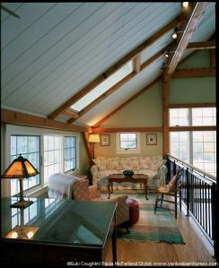 The loft area just above the dining room is open to the great room below.