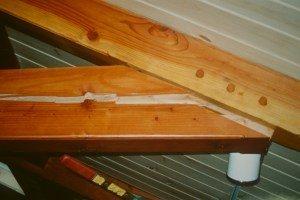Badly cracked beams in a timber frame