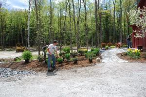 The garden by the entrance walkway gets installed.