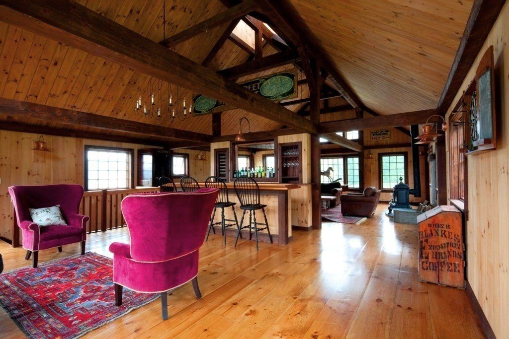 A post beam carriage house in vermont for Carriage house flooring