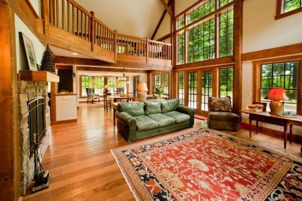 Yankee barn homes barnstyle home on lake charlevoix michigan for Interior pictures of post and beam homes