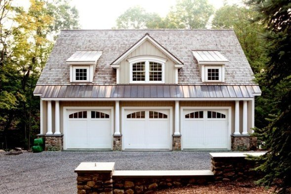 The many faces of post and beam style from yankee barn homes for Hillside garage doors