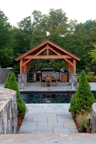A Post And Beam Pavilion With Outdoor Kitchen