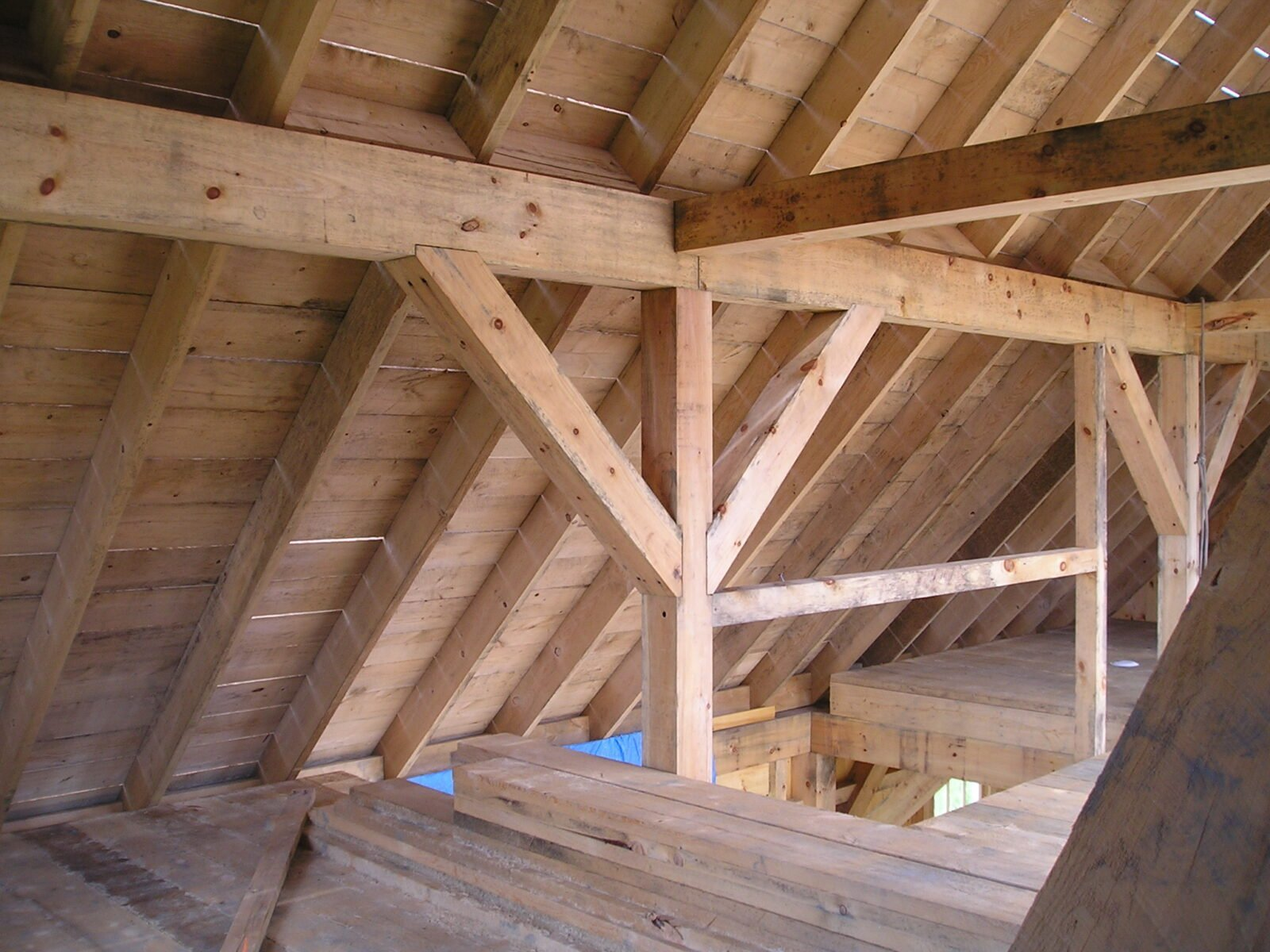 Interior beam work in Christmas Tree Barn