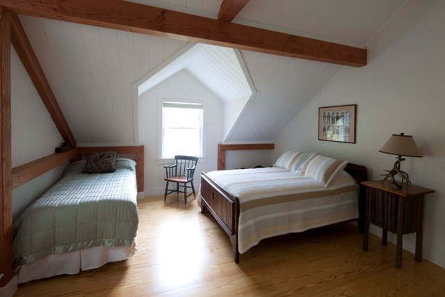 post and beam vacation cottage guest bedroom
