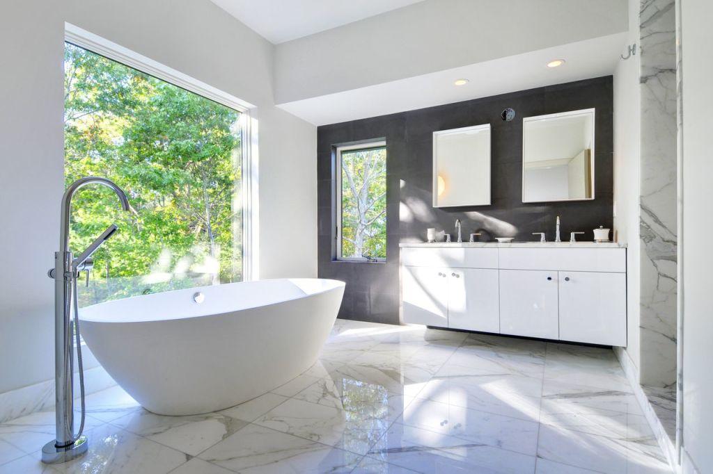 Sleek modern bathroom in Contemporary Barn Home