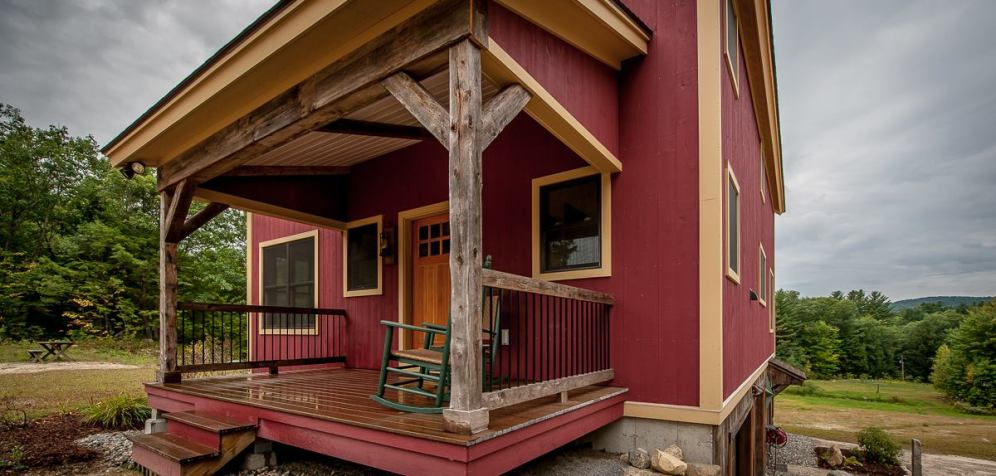 Small barn house is grand for Open beam front porch